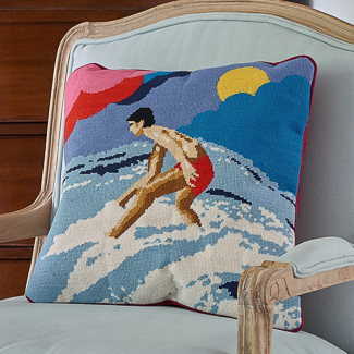 'By the Seaside' category page; Ehrman Tapestry cushion from the 'By the Seaside' collection with a surfer motif on it.