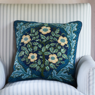 'Medieval' category page; Ehrman Tapestry cushion from the 'Medieval' collection with a floral motif on it.