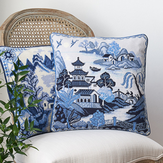 'Inspired by Asia' category page; Ehrman Tapestry cushion from the 'Inspired by Asia' collection with a rendition of the famous Willow Pattern.