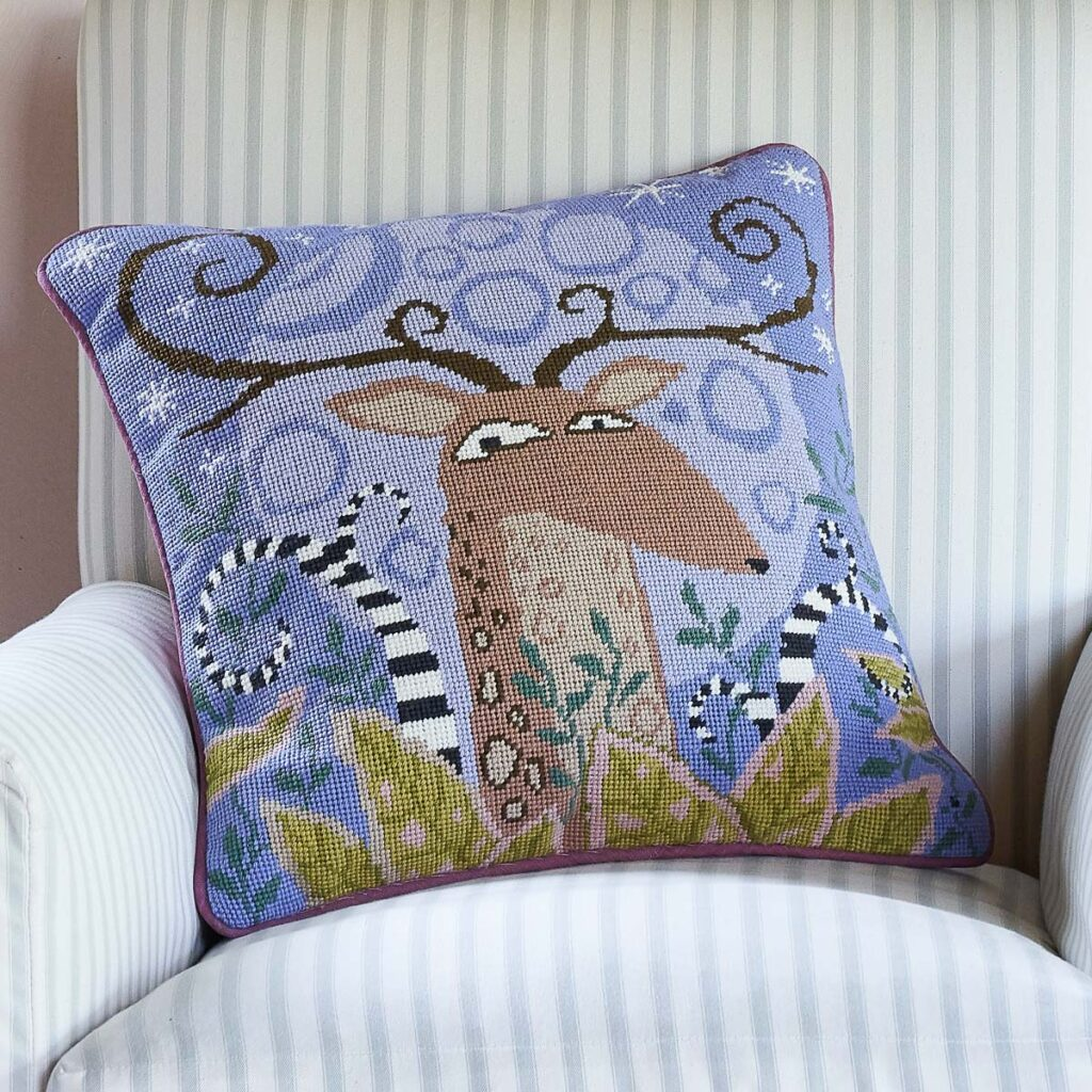 'Birds & Beasts' category page; Ehrman Tapestry cushion from the 'Birds & Beasts' collection with a stag motif on it.